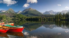 The colorful boats on lake in High Tatras Royalty Free Stock Image