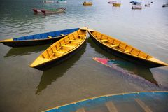 Colorful boats on Lake. Phewa, Pokhara, Nepal royalty free stock photography