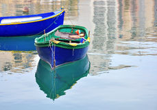 Colorful boats in Malta. Colorful maltese boats with reflection in mediterranean sea Royalty Free Stock Photography