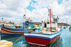 Colorful boats at Marsaxlokk Harbor Malta Stock Photography