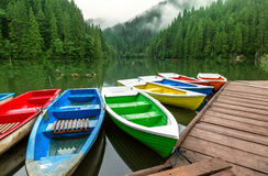 Colorful boats moored on a mountain lake Stock Photography