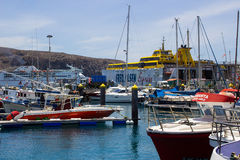 Colorful boats packed into the harbor and marina at Los Cristianos ferry terminal  in Tenerife on a hot summer day Royalty Free Stock Photos