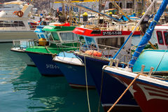 Colorful boats packed into the harbor and marina at Los Cristianos ferry terminal  in Tenerife on a hot summer day Royalty Free Stock Images