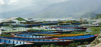 Colorful boats parked on the bank of Phewa lake Royalty Free Stock Images