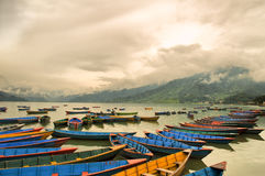 Colorful boats on Phewa lake. Pokhara Nepal Stock Image