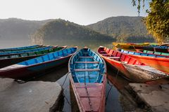 Colorful boats in Phewa lake in Pokhara, Nepal Stock Images