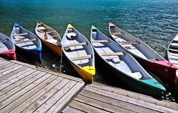 Abstract of Colorful boats docked at Moraine lake in Canada. Colorful boats ready for tourist canoeing experience at most beautiful moraine lake in banff Stock Photo