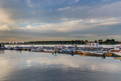 Colorful boats at river Danube in the evening light stock images