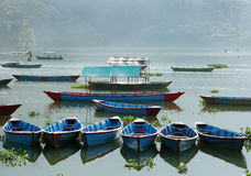 Colorful boats in a row in Phewa lake Stock Photos