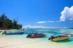Colorful boats at sea shore Royalty Free Stock Photos
