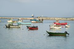 Colorful boats at sunset in Cascais, the popular seaport north of Lisbon/Lisboa Portugal Stock Image