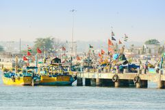 Colorful boats tied on fishing jetty in Diu royalty free stock photo