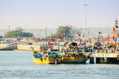 Colorful boats tied on fishing jetty in Diu royalty free stock images