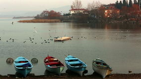 Colorful boats and tranquil lake scene stock video footage