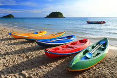 Colorful boats on the tropical beach of Thailand. Stock Photos