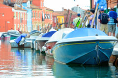 Colorful boats on Venetian island of Burano Stock Images