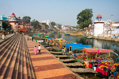 Colorful boats wait for the passengers at the river docks of indian city Stock Photos