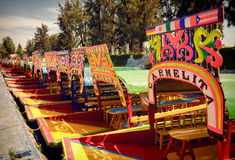 Colorful Boats of Xochimilco parked in a Row Royalty Free Stock Image