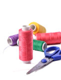 Colorful bobbin thread on white background Stock Images
