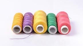 Colorful bobbin thread on white background Stock Image