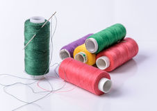Colorful bobbin thread on white background Stock Photography