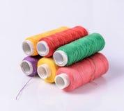 Colorful bobbin thread on white background Royalty Free Stock Photos