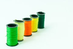 Colorful bobbin threads. Arranged in line using for embroidery works Stock Photos