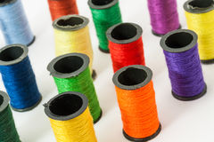 Colorful bobbin threads. Arranged in up right position using for embroidery works Royalty Free Stock Photography
