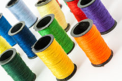 Colorful bobbin threads. Arranged in up right position using for embroidery works Stock Photo