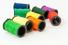 Colorful bobbin threads. Collection of Colorful bobbin threads lying using for embroidery works Royalty Free Stock Images