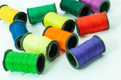 Colorful bobbin threads. Collection of Colorful bobbin threads lying using for embroidery works Royalty Free Stock Photo