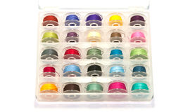 Colorful bobbins. Box of colorful bobbins on white background Royalty Free Stock Image
