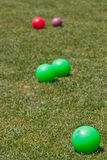 Colorful Bocce Balls in Green Grass Stock Photos