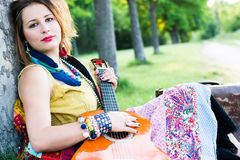 Colorful Bohemian Woman with Guitar Stock Photo