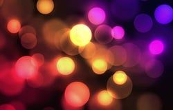 Colorful bokeh. Yellow red orange purple bokeh Stock Photo