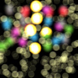 Colorful bokeh, abstract background in hues. Colorful bokeh with small blurred circles on black background and lights. Abstract texture and design stock photography