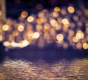 Colorful bokeh background. Colorful bokeh background reflected in water stock photo