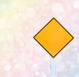 Colorful bokeh background and traffic sign Royalty Free Stock Photos