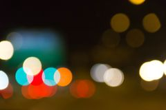 Colorful bokeh on blurred background. Colorful light bokeh on blurred night background stock photo