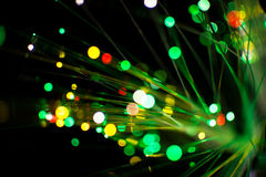 Colorful bokeh circle light celebrate at night, defocus light abstract green background. Royalty Free Stock Images