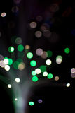 Colorful bokeh circle light celebrate at night, defocus light abstract green background. Stock Photography