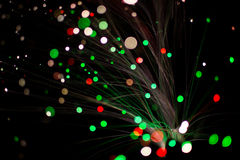 Colorful bokeh circle light celebrate at night, defocus light abstract green and red background. Royalty Free Stock Images