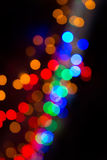 Colorful bokeh on a dark background. Defocused bokeh lignts. Abstract Christmas batskground. Abstract circular bokeh background of Royalty Free Stock Photography