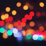 Colorful bokeh on a dark background. Defocused bokeh lignts. Abstract Christmas batskground. Abstract circular bokeh background of Stock Photography