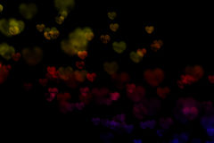 Colorful bokeh hearts. A background of bokeh hearts of different colors royalty free stock photos