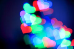 Colorful bokeh hearts. On blue background Royalty Free Stock Photography