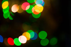 Colorful bokeh lights on black background Stock Photos