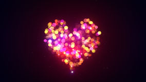 Colorful bokeh lights heart shape Stock Images
