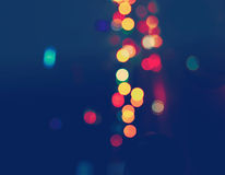 Colorful Bokeh On A Navy Blue Background Royalty Free Stock Image