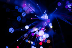 Colorful bokeh purple light celebrate at night, defocus light abstract background. Royalty Free Stock Photo